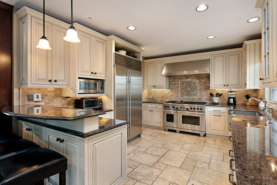 Kitchen remodel in Woodland Park with bar seating and custom kitchen cabinets